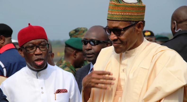 President Muhammadu Buhari (R) and Delta State Governor, Ifeanyi Okowa. [Twitter/@BashirAhmaad]