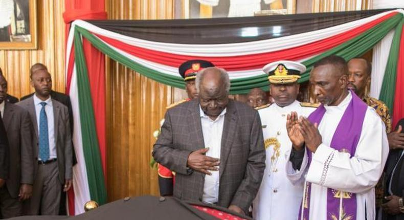 Retired President Mwai Kibaki viewing the body of predecessor, former President Daniel Arap Moi on Saturday, February 9