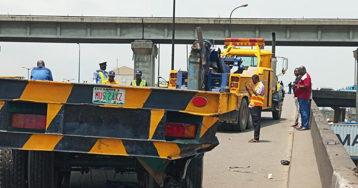 Container-laden truck falls in Lagos, damages car, motorcycle - Pulse Nigeria