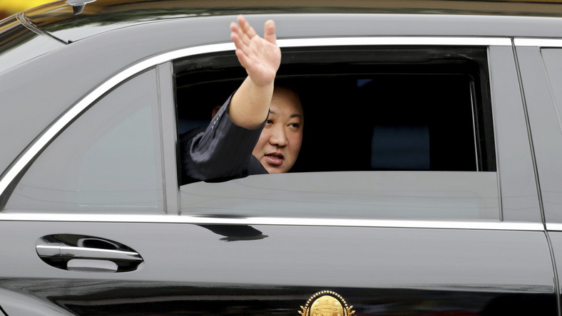 North Korean leader Kim Jong Un waves from a car after arriving by train in Dong Dang in Vietnamese border town Tuesday, Feb. 26, 2019, ahead of his second summit with U.S. President Donald Trump. (AP Photo/Minh Hoang)