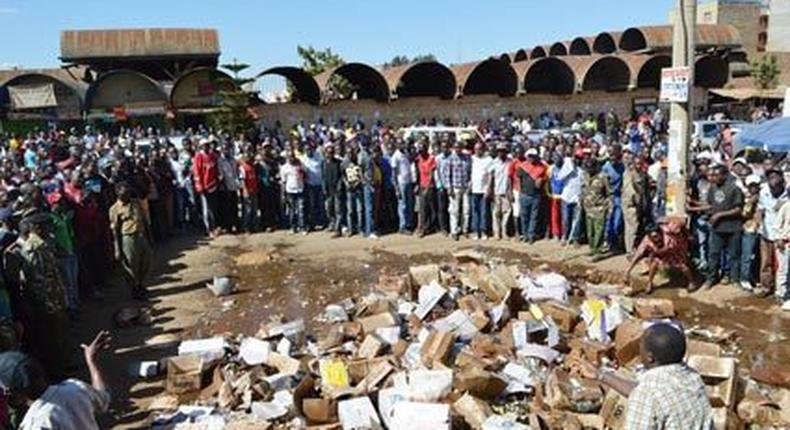 File image of members of the public destroying illegal liquor