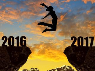 Girl jumps across the gap to the New Year 2017 gap year