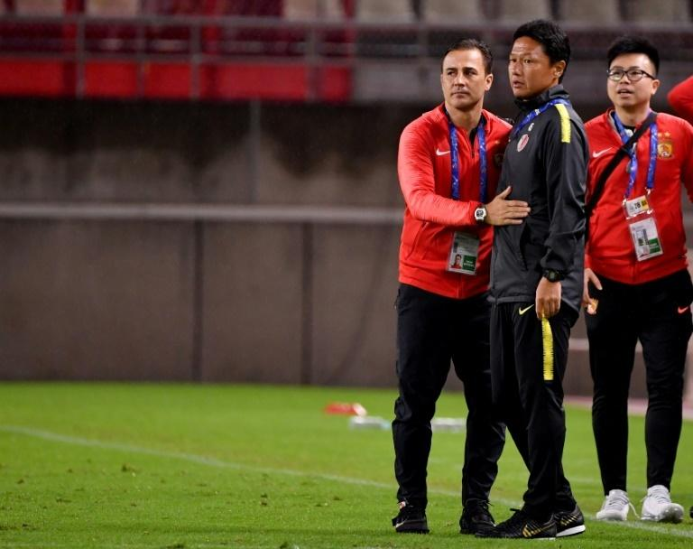 Guangzhou manager Fabio Cannavaro (left) is congratulated by Kashima's Go Oiwa at the final whistle
