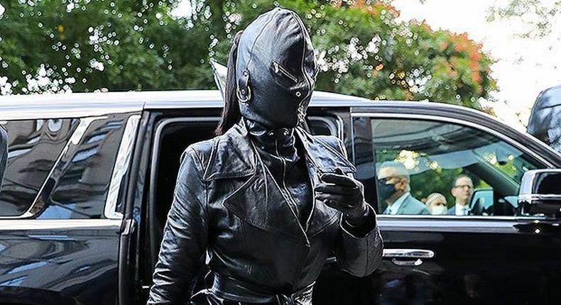 "Kim Kardashian seen wearing a tied trench coat, leather pants and high heeled boots, along with a rhinestone ""Hourglass handbag. Photo by: Felipe Ramales / SplashNews.com"