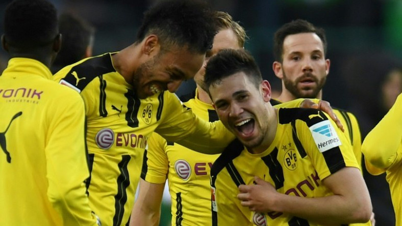 Dortmund's defender Raphael Guerreiro and striker Pierre-Emerick Aubameyang react after a German first division Bundesliga football against Borussia Moenchengladbach on April 22, 2017