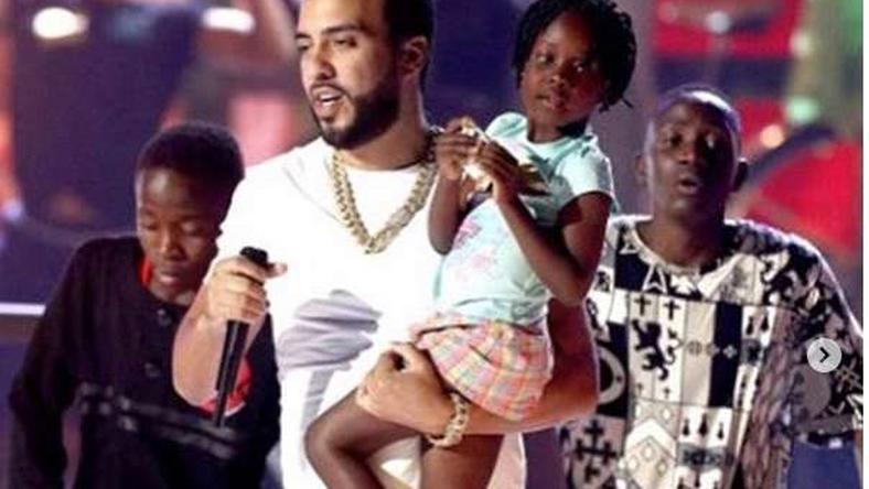 French Montana with The Dancing Ghetto Kids. American Rapper French Montana gifts Uganda Ghetto Kids with multi-million Mansion