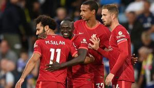 Liverpool's Sadio Mane (C) celebrates with Mohamed Salah (L) Creator: Oli SCARFF