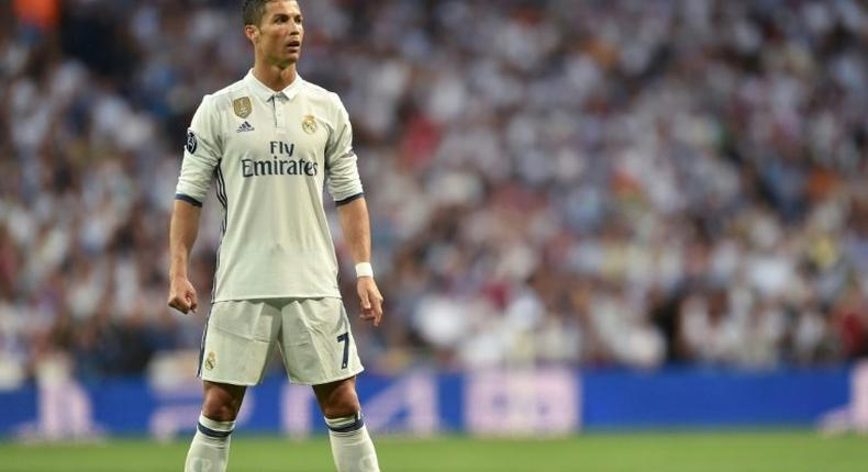 Real Madrid's Portuguese forward Cristiano Ronaldo prepares for a free kick during the UEFA Champions League quarterfinal match against Bayern Munich at the Santiago Bernabeu stadium in Madrid, Spain, on April 18, 2017
