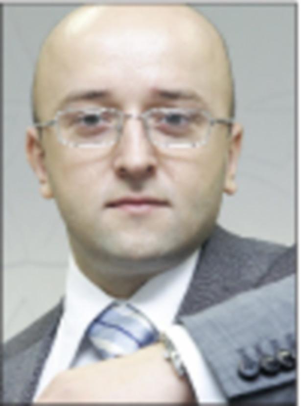 Mateusz Ostrowski, analityk Open Finance