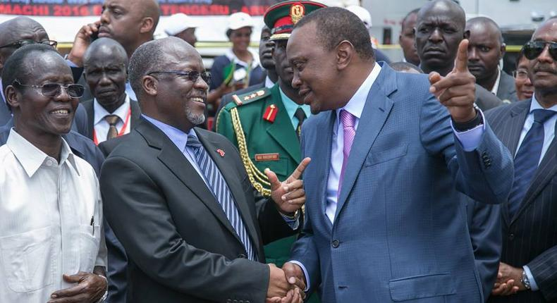 Tanzanian President John Magufuli (L) shaking hands with Kenyan President Uhuru Kenyatta at a past event.