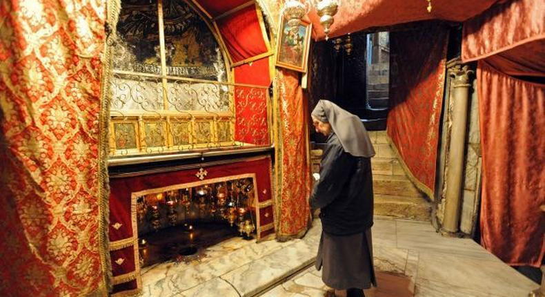A nun prays in front of the star marking the site where it is believed Jesus was born inside the church of Nativity. (Catholic Philly)