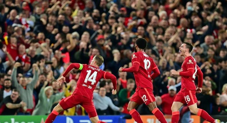 Jordan Henderson (left) celebrates scoring Liverpool's winner against AC Milan Creator: Paul ELLIS