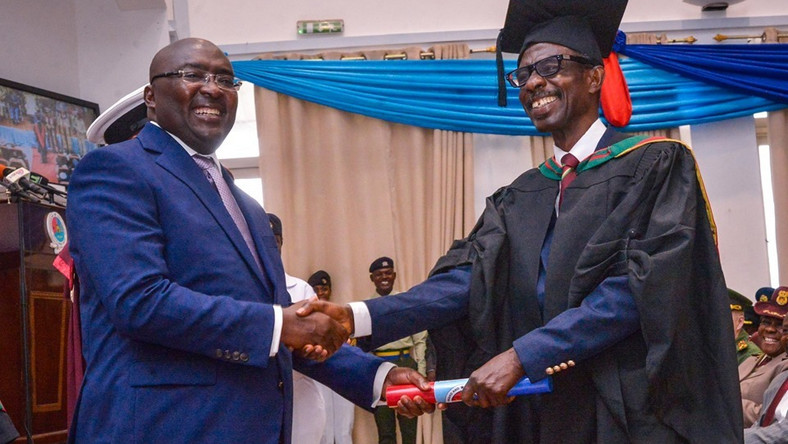 Dr Bawumia  with 'General Mosquito' as he grabs Master's degree