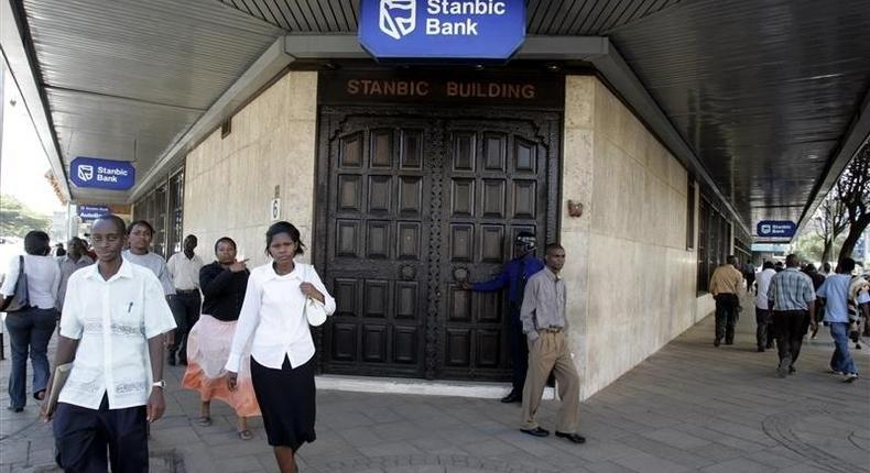 Kenyan city residents walk past Stanbic Bank in the capital Nairobi  in a file photo.  REUTERS/Antony Njuguna