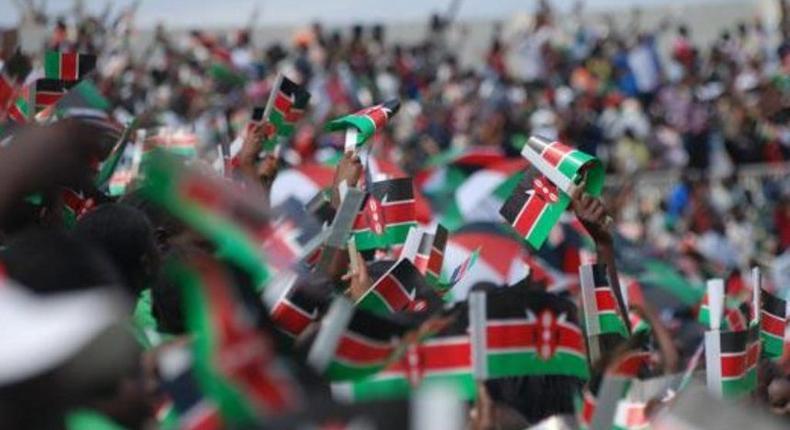Kenyans waving flags