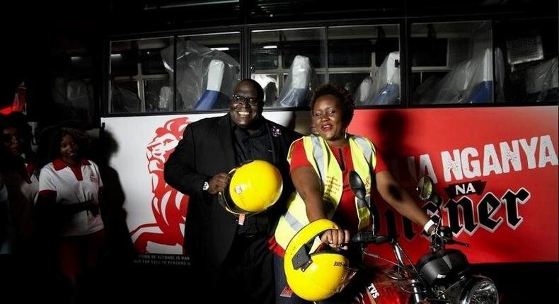 Pilsner Marketing Manager, Samuel Wasswa and Pilsner Senior Brand Manager, Truphena Malaki on the KBL/Pilsner bike to be worn