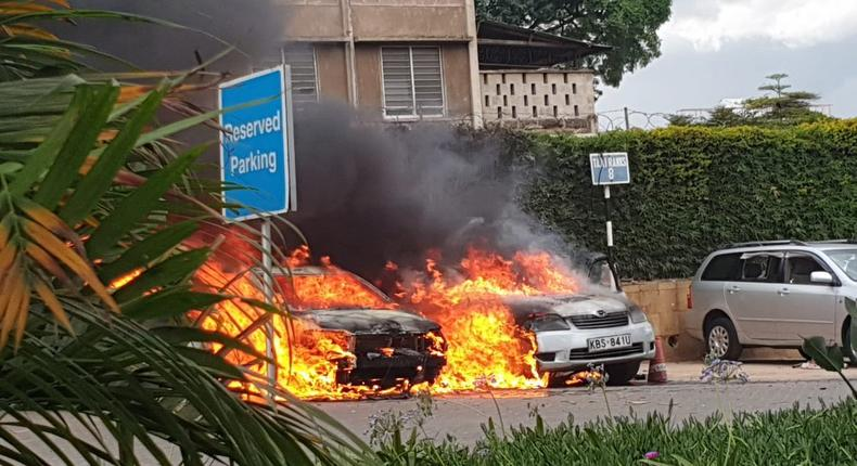 Vehicles burning at the Dusit complex