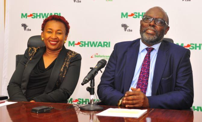 Safaricom Director, Special Projects Sylvia Mulinge (R) and Isaac Awuondo, CBA Group Managing Director.
