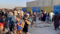 People who want to flee the country continue to wait around Hamid Karzai International Airport in Kabul, Afghanistan on August 25, 2021.