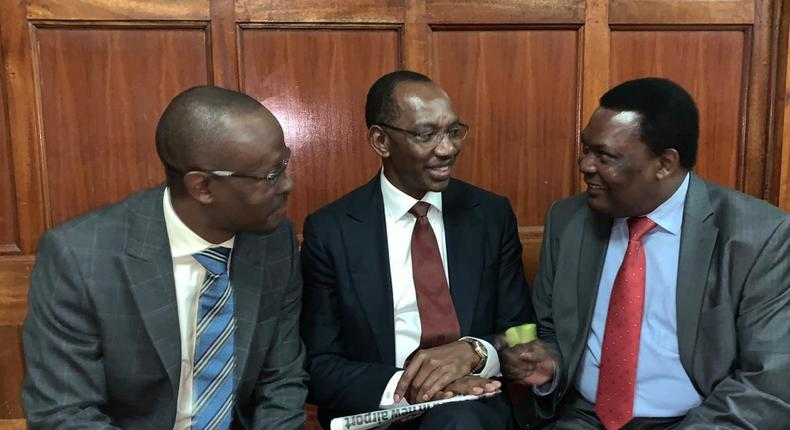 Businessman Humphrey Kariuki with his lawyers during a past court appearance