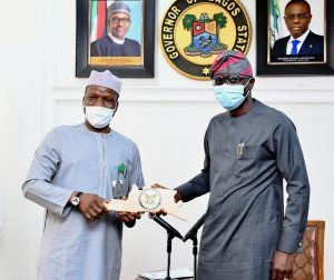Managing Director of the Federal Airports Authority of Nigeria (FAAN), Capt. Rabiu Hamisu Yadudu (left), receiving a plaque from Lagos State governor, Babajide Sanwo-Olu (right), during a courtesy visit to the governor at Lagos House, Alausa, Ikeja, on Tuesday, September 1, 2020 [NANn