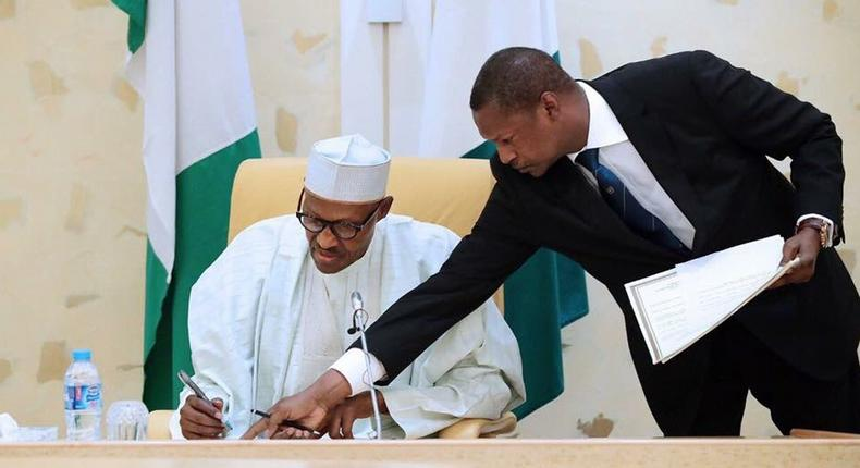 AGF Malami and President Buhari sign dotted lines (Presidency)
