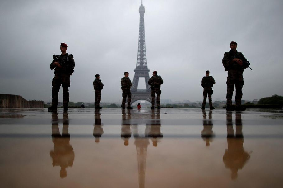 "French soldiers patrol near the Eiffel Tower as part of the ""Sentinelle"" security plan in Paris"