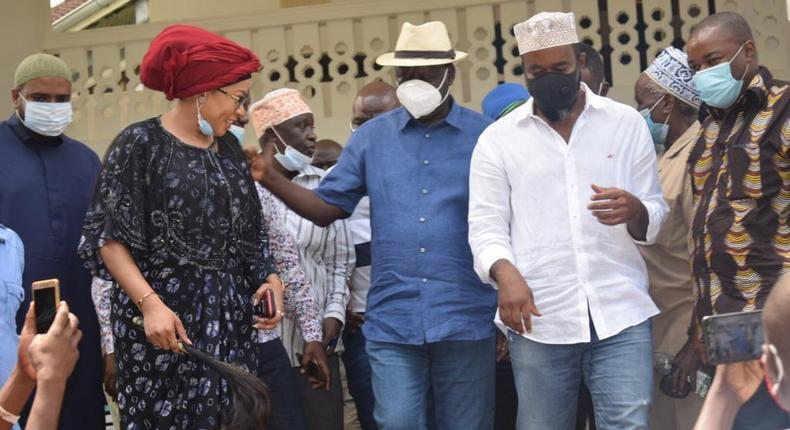 Mariam Sharlet (red scarf) with ODM party leader Raila Odinga and deputy PL Hassan Joho