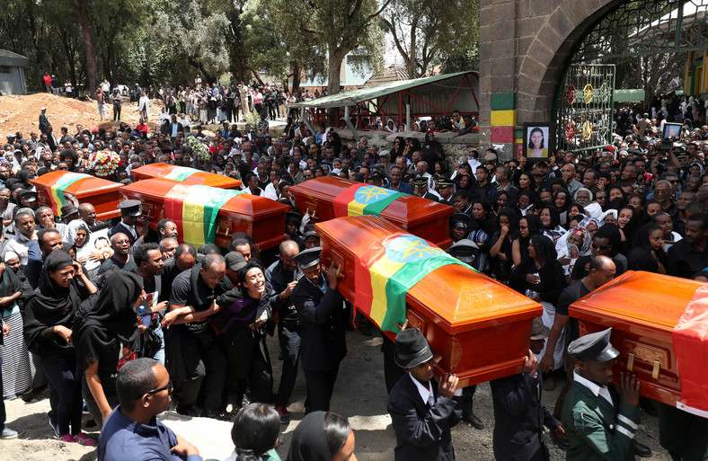 Pallbearers carry the coffins of the victims of the Ethiopian Airline Flight ET 302 plane crash, during the burial ceremony at the Holy Trinity Cathedral Orthodox church in Addis Ababa.