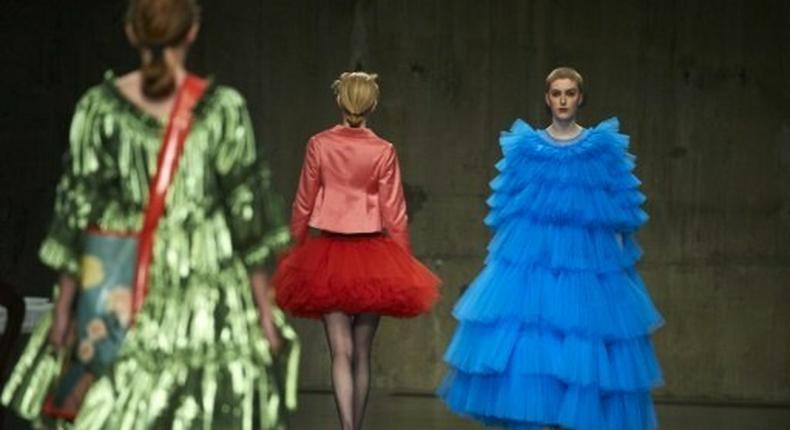 Models present creations by British designer Molly Goddard during London Fashion Week