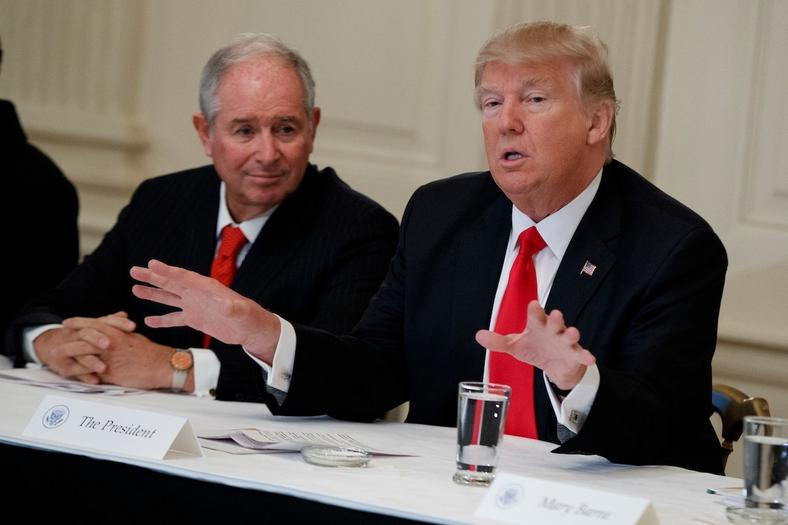 Blackstone CEO Stephen Schwarzman listens as President Donald Trump speaks during with business leaders in the State Dining Room of the White House on Feb. 3, 2017.