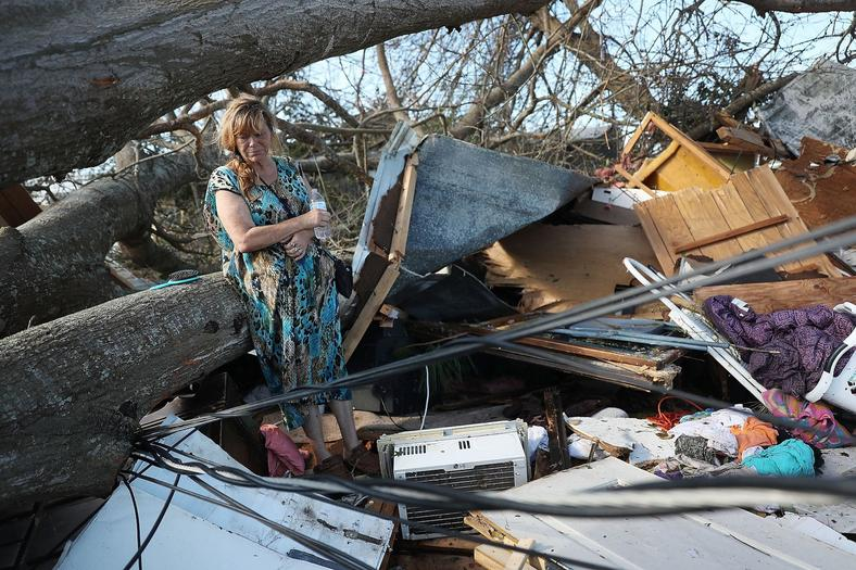 Kathy Coy stands among what is left of her home after Hurricane Michael destroyed it. She said she was in the home when it was blown apart and is thankful to be alive.