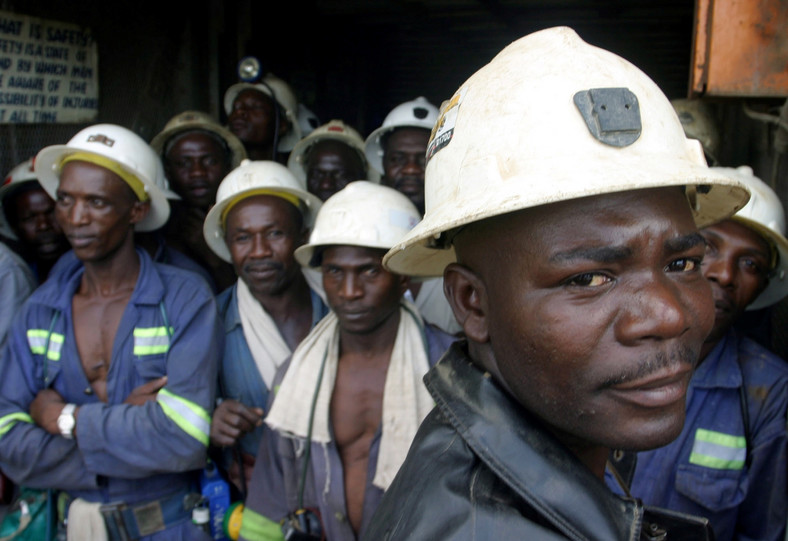 Konkola Copper Mines PLC workers wait in a lift before going to work underground in this picture taken April 12, 2005 in Konkola, Zambia.