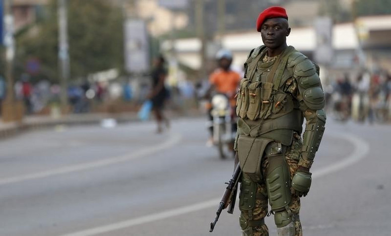A soldier holds his weapon as he watches a procession by Uganda's leading opposition party Forum for Democratic Change supporters being dispersed in Kampala, Uganda, February 15, 2016.