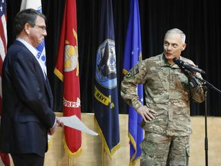 Terry introduces Carter to speak to troops at a question-and-answer session at Camp Arifjan, Kuwait