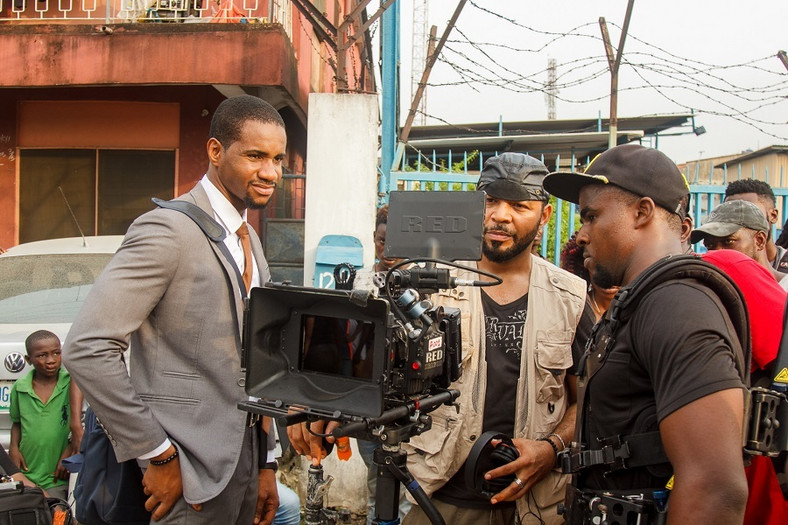 Swanky JKA getting instructions from Ramsey Nouah in a scene from 'Living in Bondage: Breaking Free'. [ R&B PR]