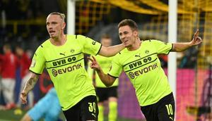 Thorgan Hazard (R) celebrates scoring for Dortmund on Tuesday in the German Cup Creator: Ina Fassbender