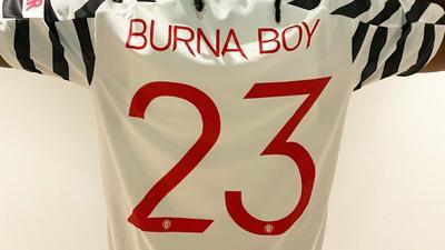 Burna Boy pays tribute to Michael Jordan in new Man United Jersey