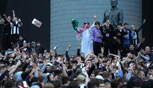 Newcastle United fans celebrate at St James' Park following the announcement that The Saudi-led takeover of Newcastle has been approved on Thursday October 7, 2021.