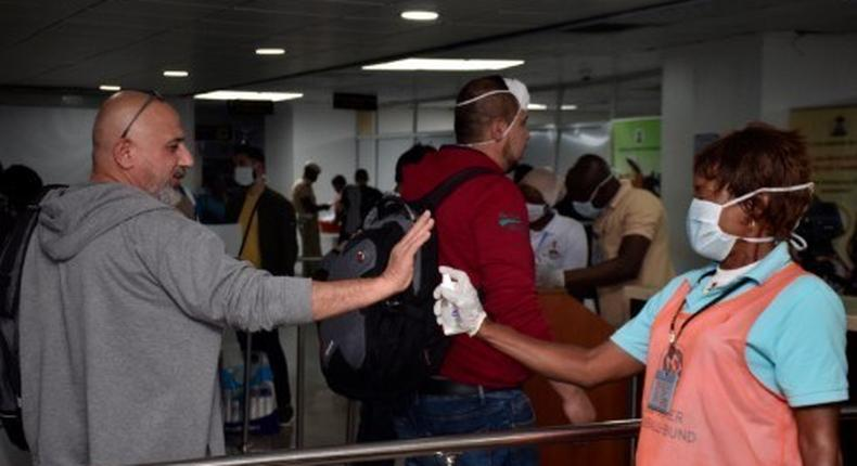 Nigerian Airports officials screening visitors coming into the country for Coronavirus. [Twitter/@MansurIB007]