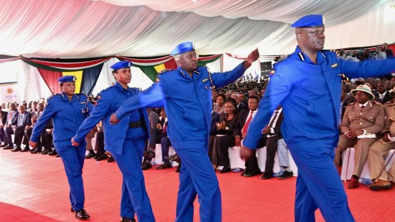 Police officers march in the new uniform unveiled by Uhuru