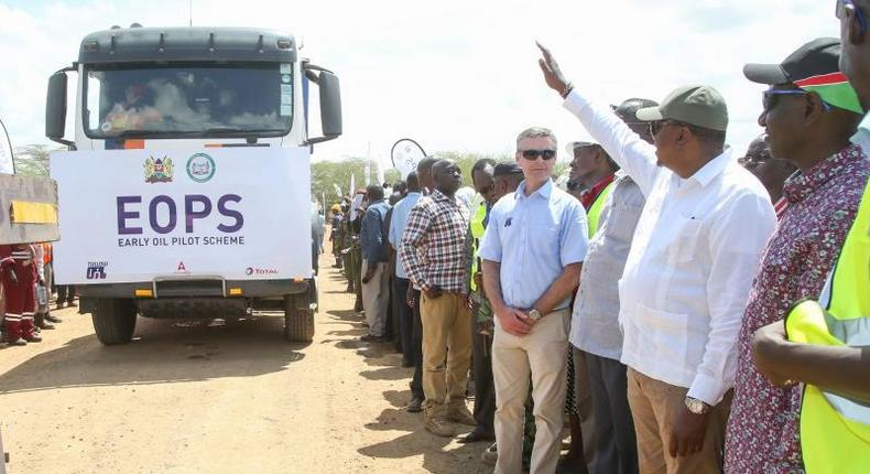 President Uhuru Kenyatta flanked by Deputy President William Ruto flags off the crude oil trucks during the Inauguration of the Ngamia 8 Early Oil Pilot Scheme, Turkana County. (The Standard)