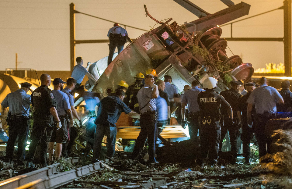 Emergency responders search for passengers following an Amtrak train derailment in the Frankfort section of  Philadelphia