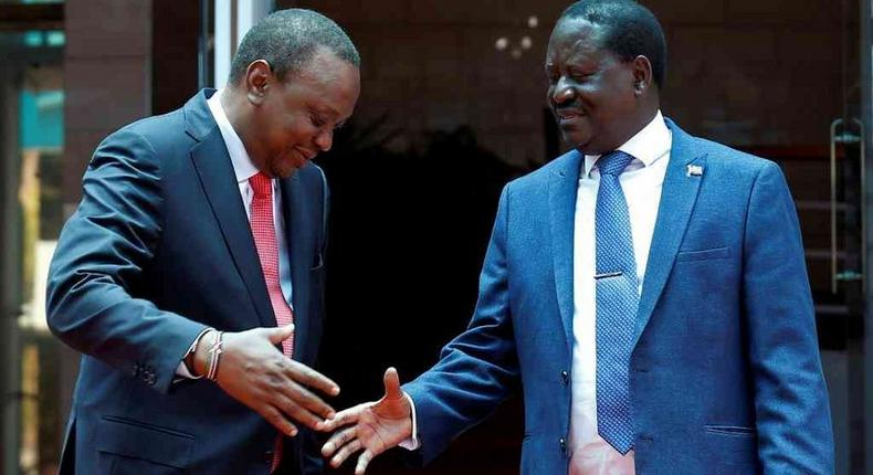 Raila Odinga with President Uhuru Kenyatta. Jubilee MP's are asking quit from politics and concentrate more on his new role as the High Representative for Infrastructure Development in Africa.