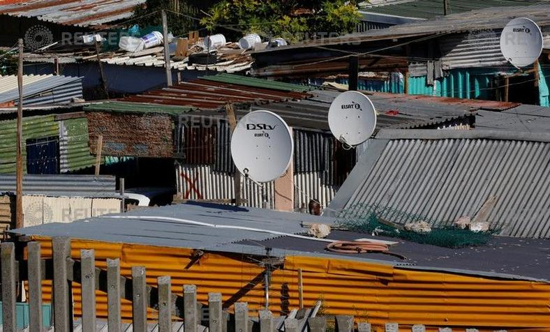 Satellite dishes connect township residents to South Africa's DSTV television network, owned by telecommunications giant Naspers, in Khayelitsha township, Cape Town, May 19, 2017.