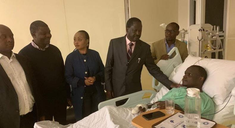 File image of Raila Odinga and other leaders when they visited ailing Norman Magaya in hospital