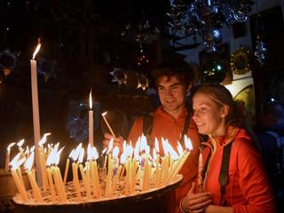 Christians Light Candles In Church Of Nativity In Bethlehem