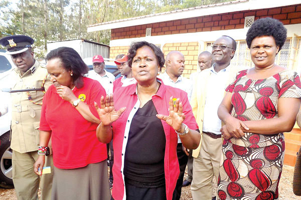 President Uhuru's sister, Kristina Pratt (centre) speaks at Tabaka Catholic Church in Kisii and Nyamira region Peter Magara who was in her campaign teamwas found dead on Saturday morning