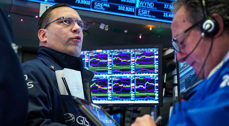 Dow surges 557 points as traders weigh bank earnings and spiking virus cases