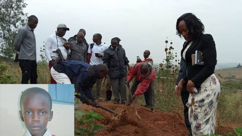 Police detectives exhume the body of 14-year-old Peter Oscar Muhairwe. (Photo by Monitor)